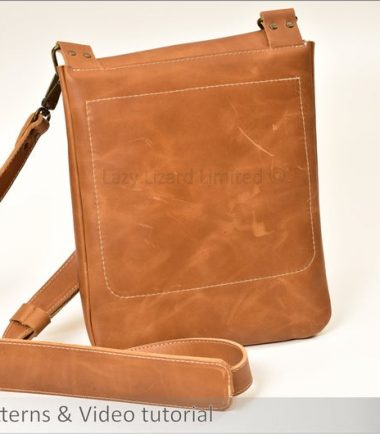 the back of a finished light brown leather bag