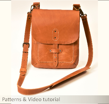 the front of a light brown cross body leather bag