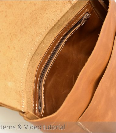 close up of the inside of a cross body leather bag