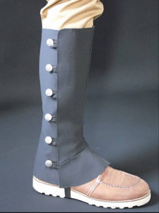 black leather spats diplayed on a model